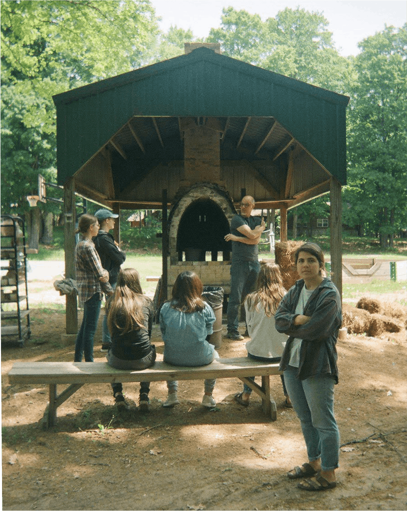 Students in front of a kiln