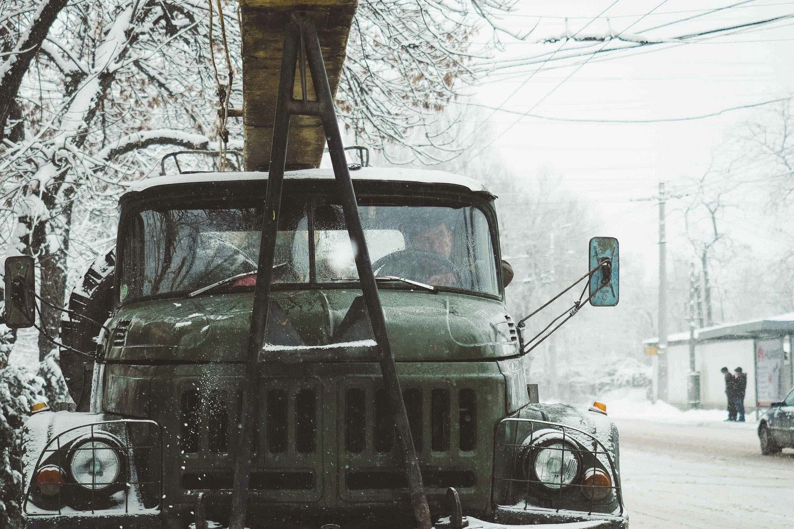 Green truck in the winter