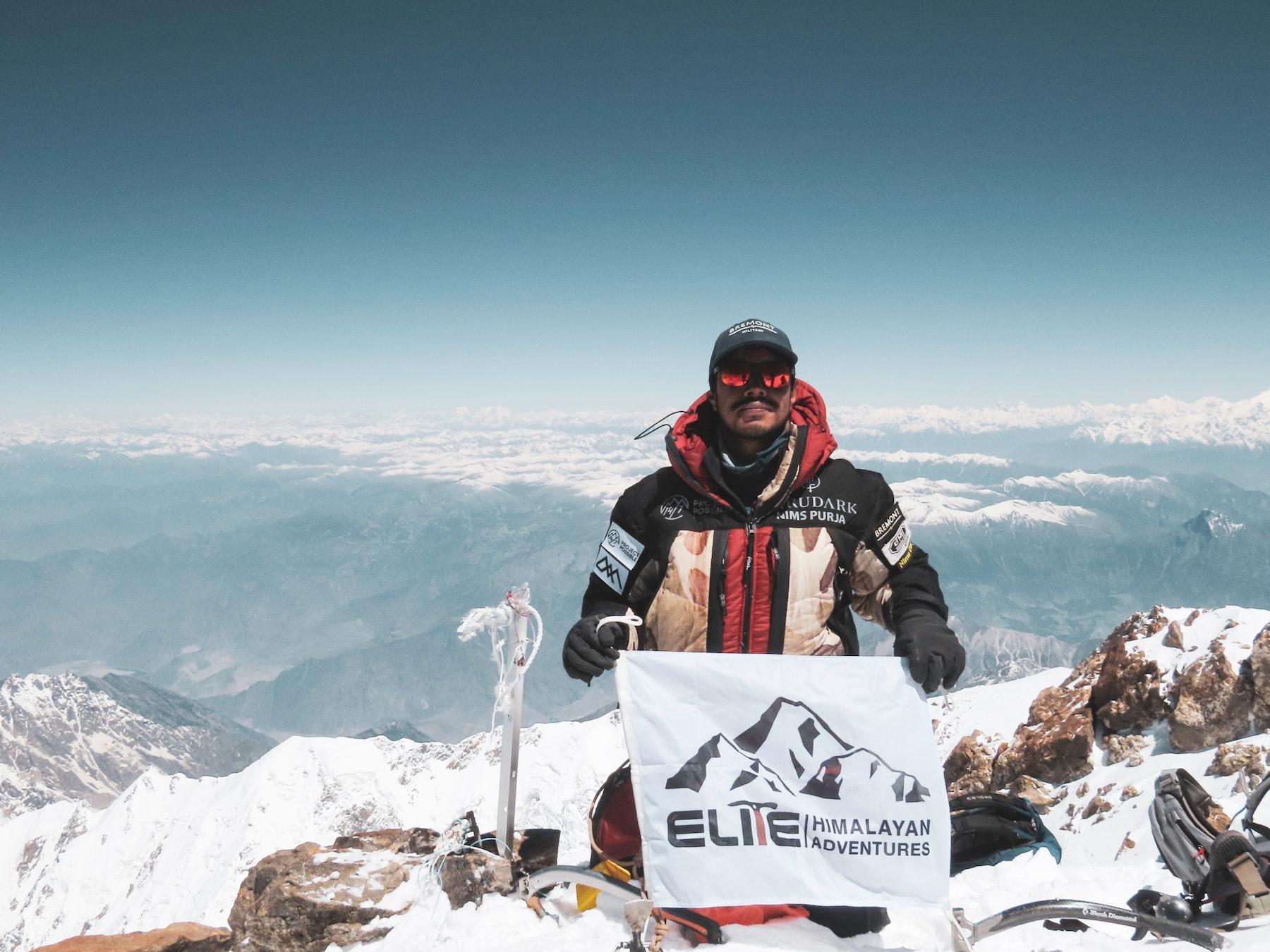 Our founder Nimsdai proudly raising Elite Himalayan Adventures flag on the summit of Nanga parbat