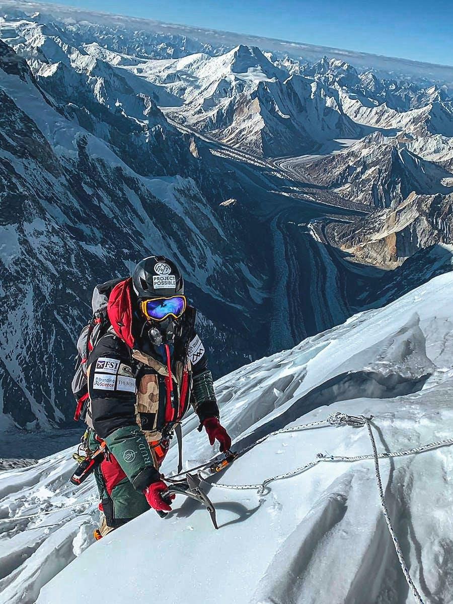 Nimsdai Purja MBE pictured climbing K2 in summer 2019 with the magnificent Baltoro Glacier below.