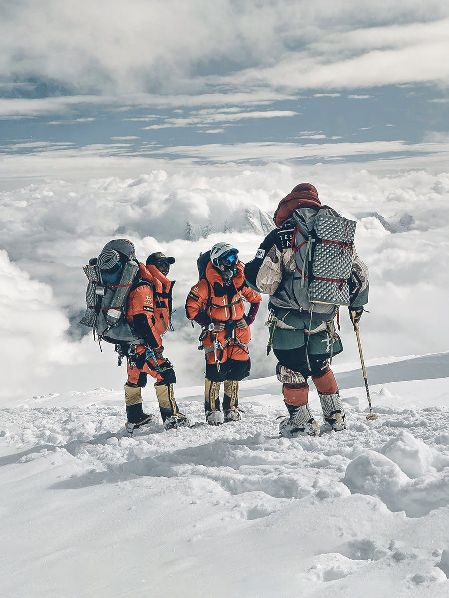 Nimsdai and team discussing strategy and progress high on Manaslu, 2019