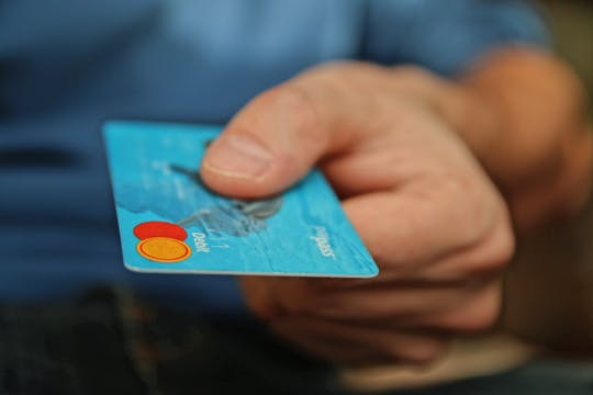 mastercard in hand