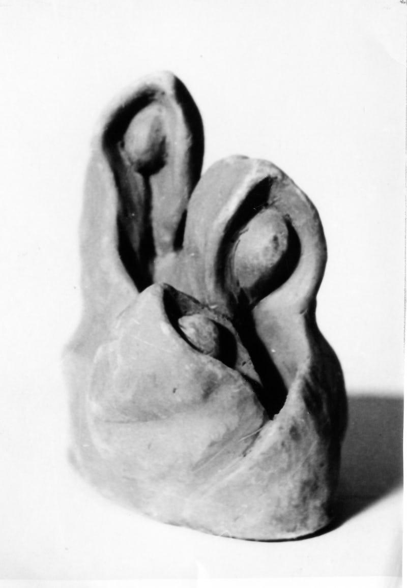 Lucrare abstractă sub forma reprezentând doi oameni