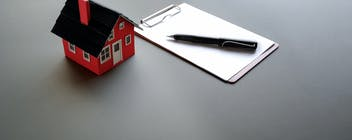 A picture of a small red house
