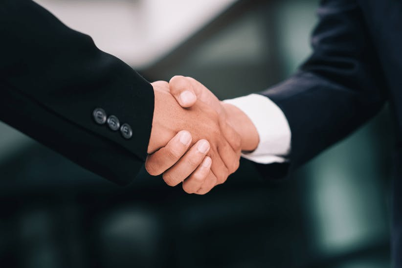 A picture of a men shaking hands
