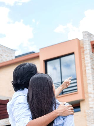 A couple looking at the new home