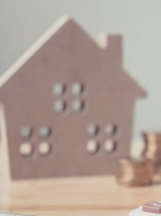 Wooden house and a calculator
