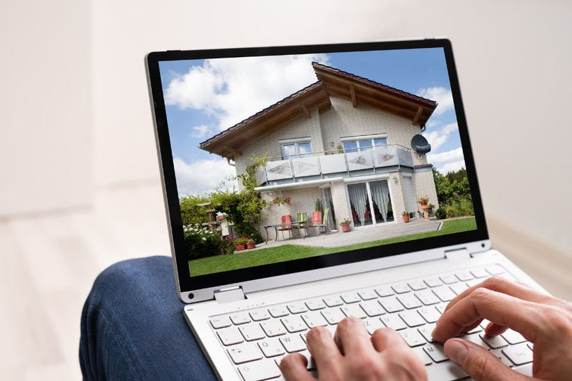 person browsing a property on a laptop