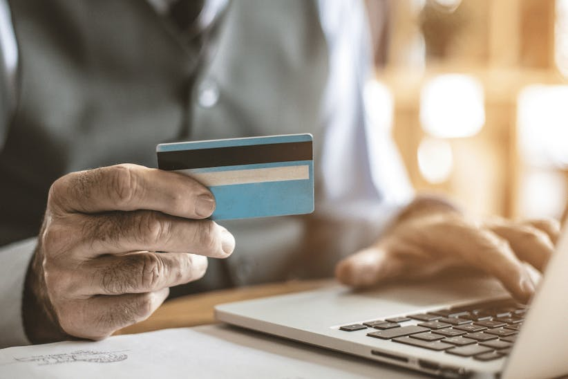 A picture of a person holding a credit card
