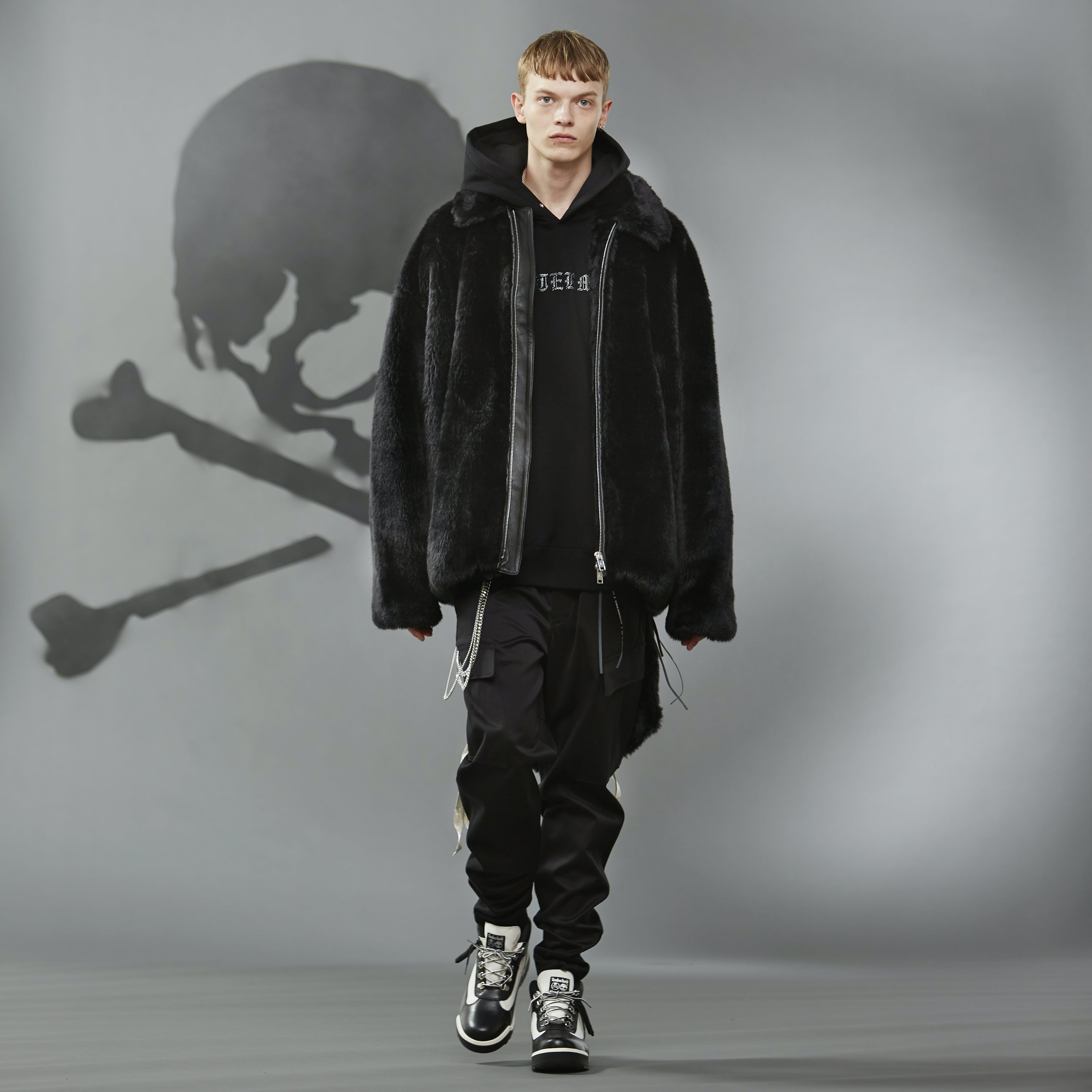 MASTERMIND WORLD FW19 look book presentation with black oversized coat