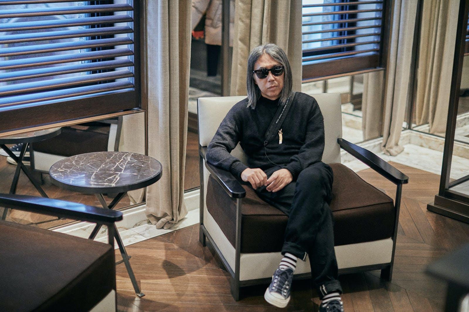 Hiroshi Fujiwara sitting in the Bont Street Moncler store