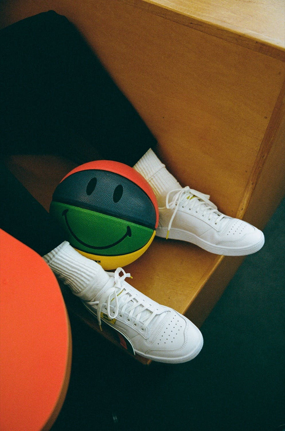 Mike Cherman wearing Puma x Chinatown Market sneaker in Dimes cafe Manhattan