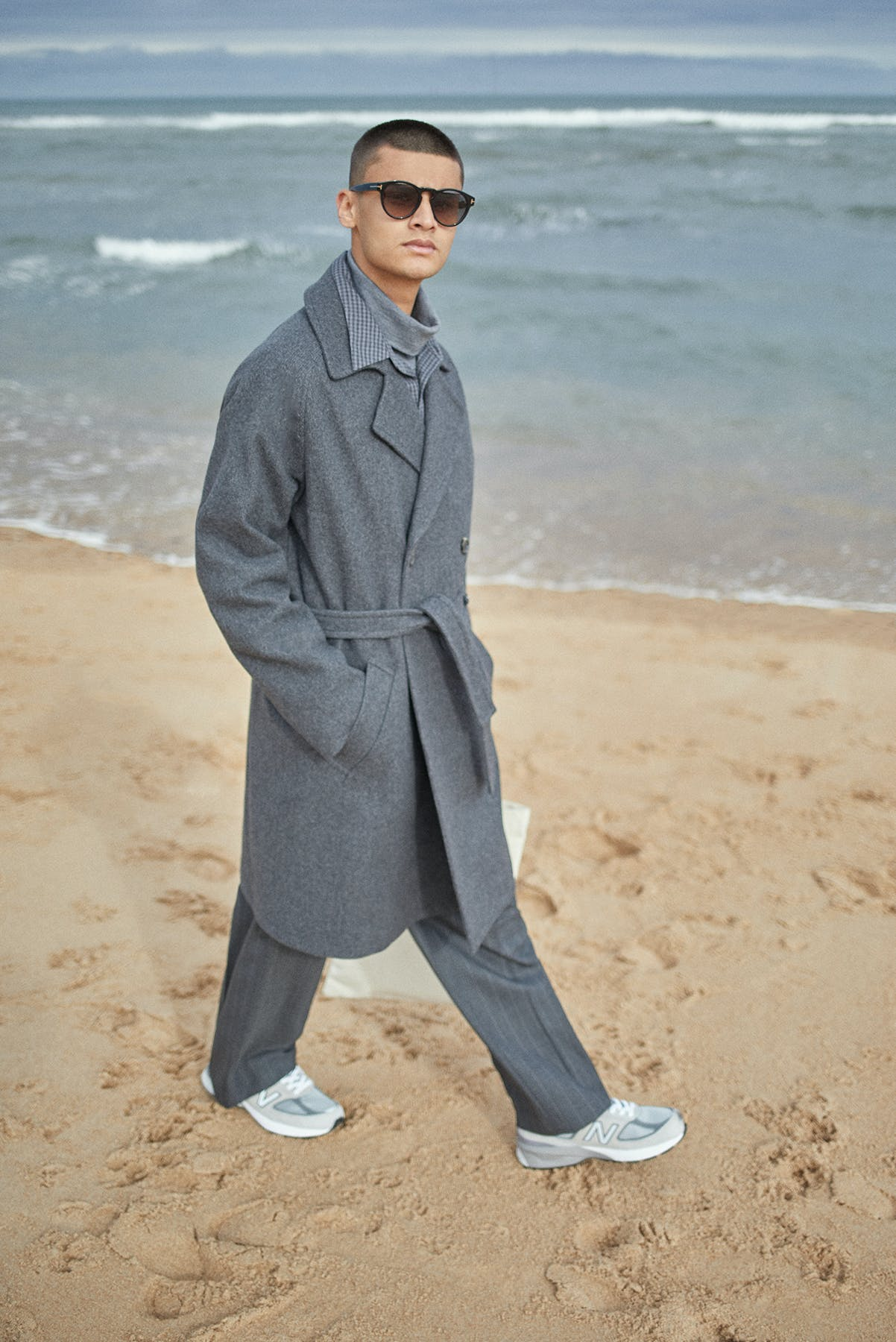 A.P.C. coat worn at the beach for Bare Minimum END. editorial