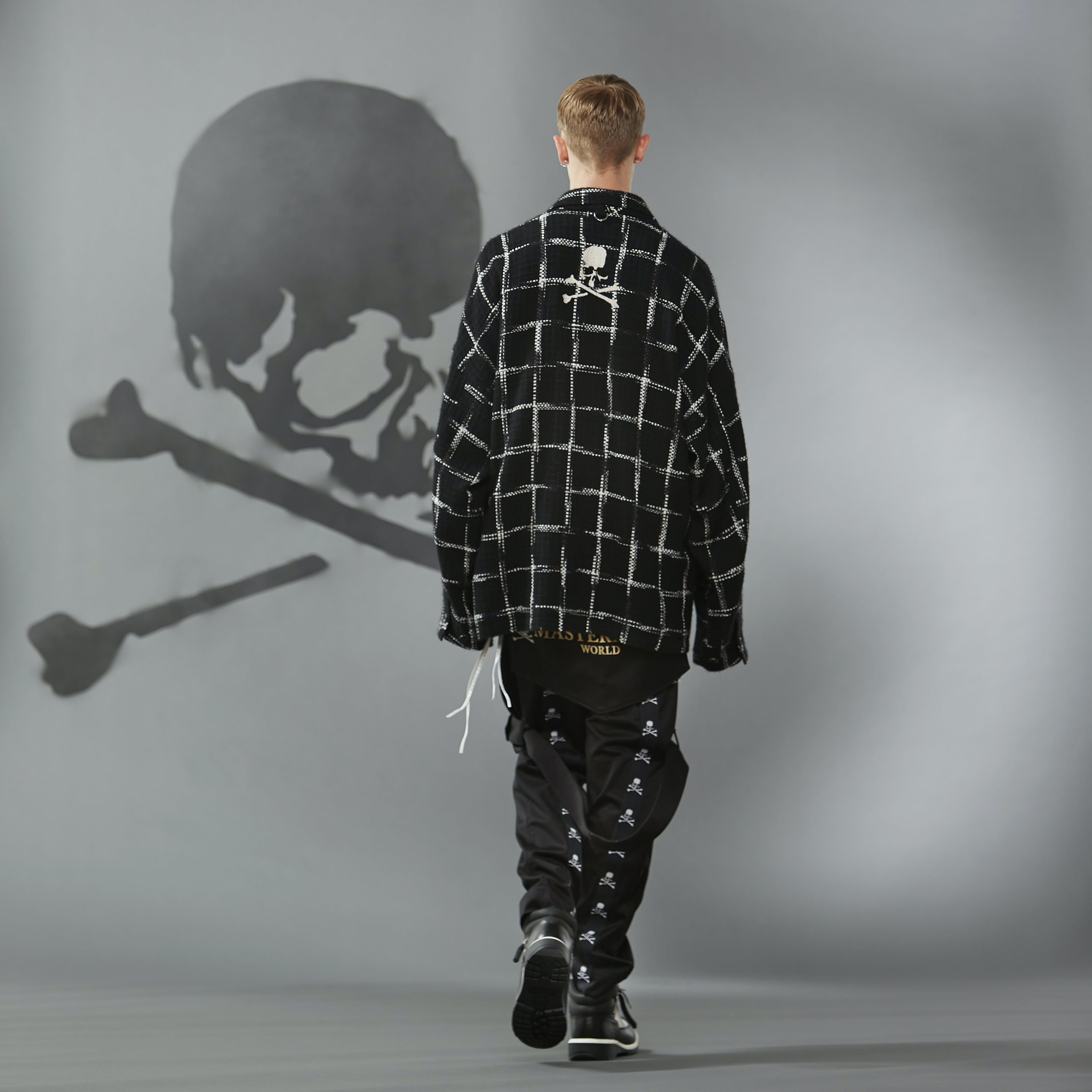 MASTERMIND WORLD FW19 look book presentation with patterned shirt