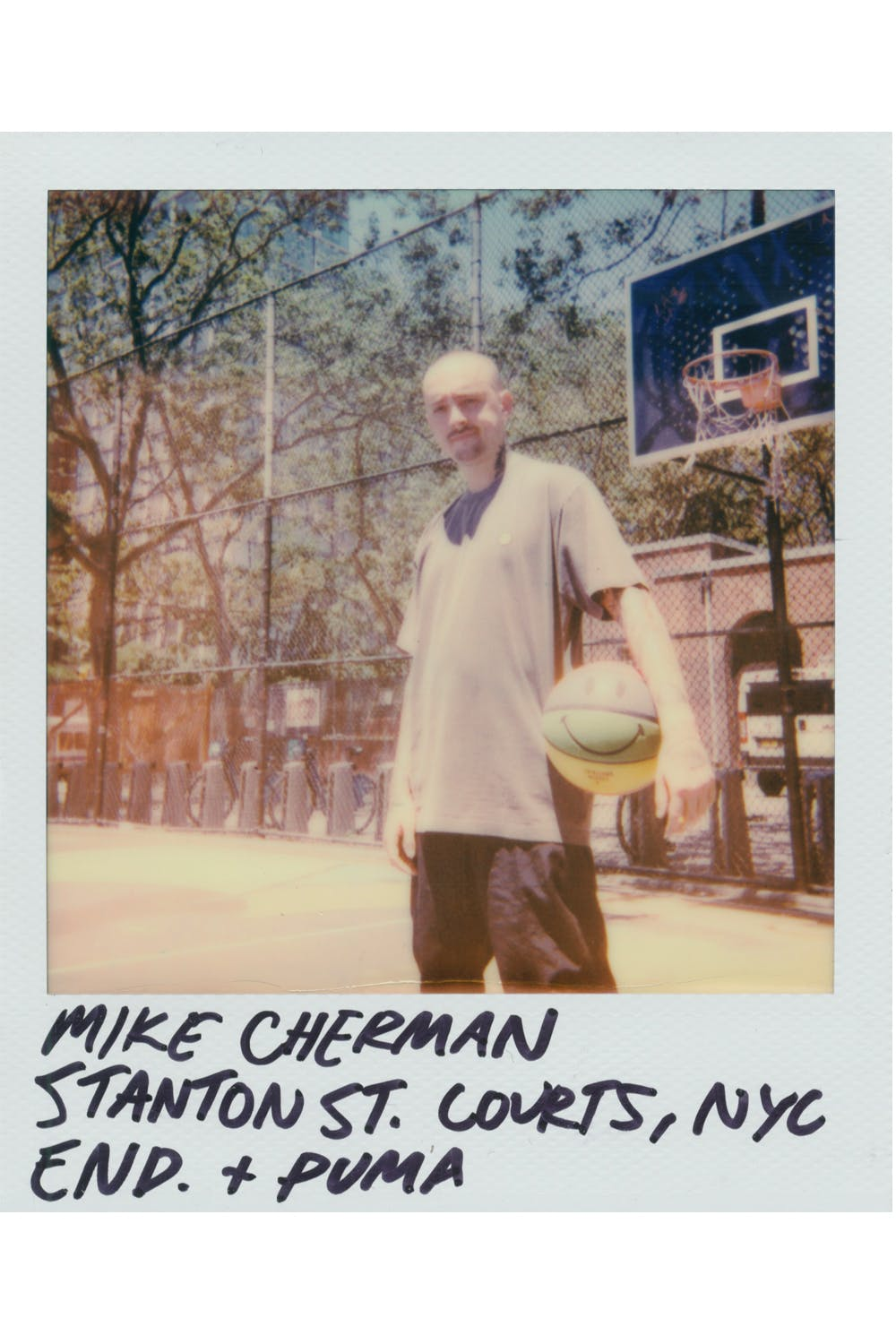Polaroid of Mike Cherman wearing Puma x Chinatown Market sneaker on basketball court in Manhattan