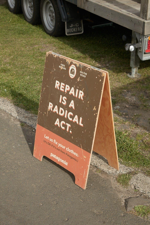 'Repair is a radical act' signage at Patagonia Worn Wear Summer Tour 2019