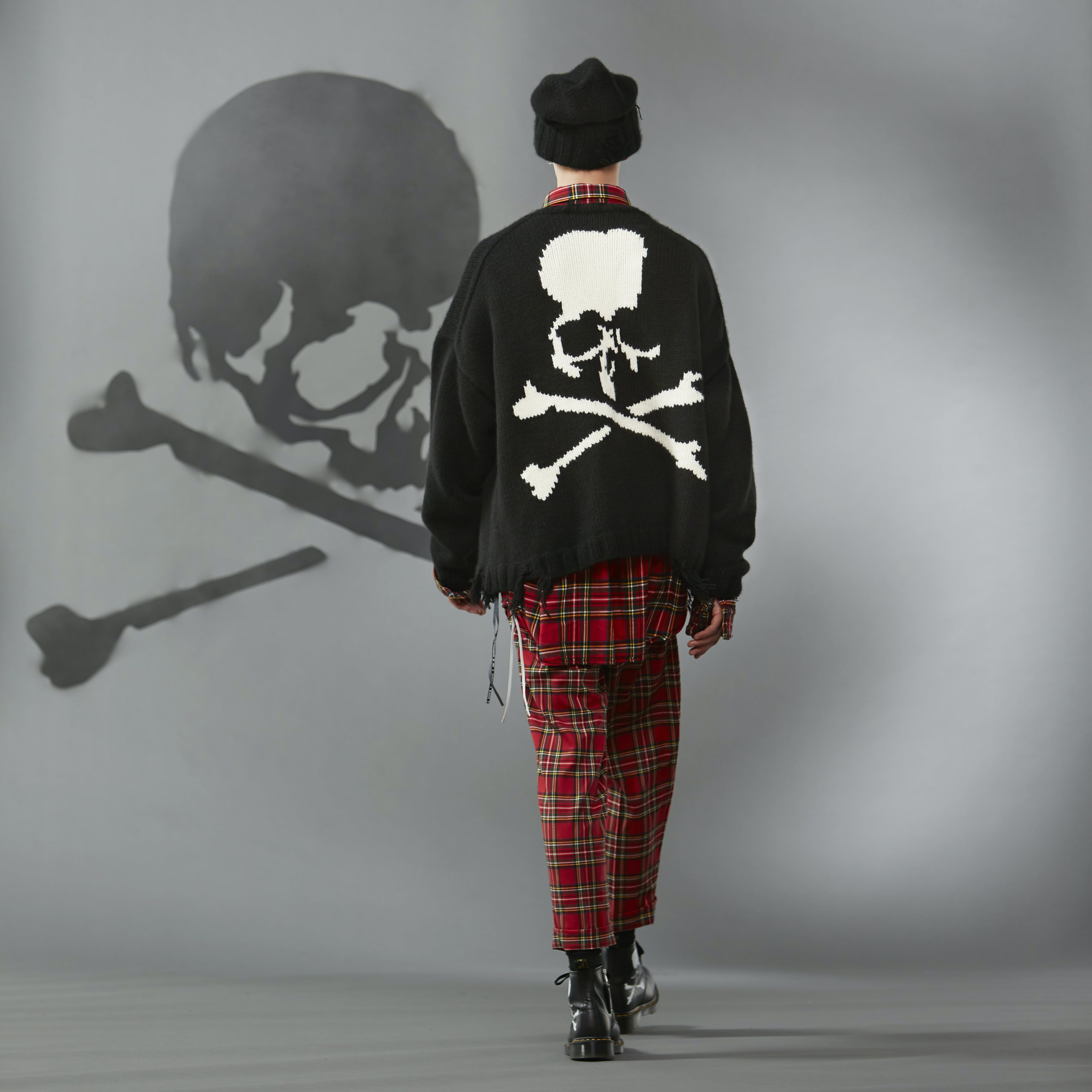 MASTERMIND WORLD FW19 look book presentation with tartan trousers and skull motif