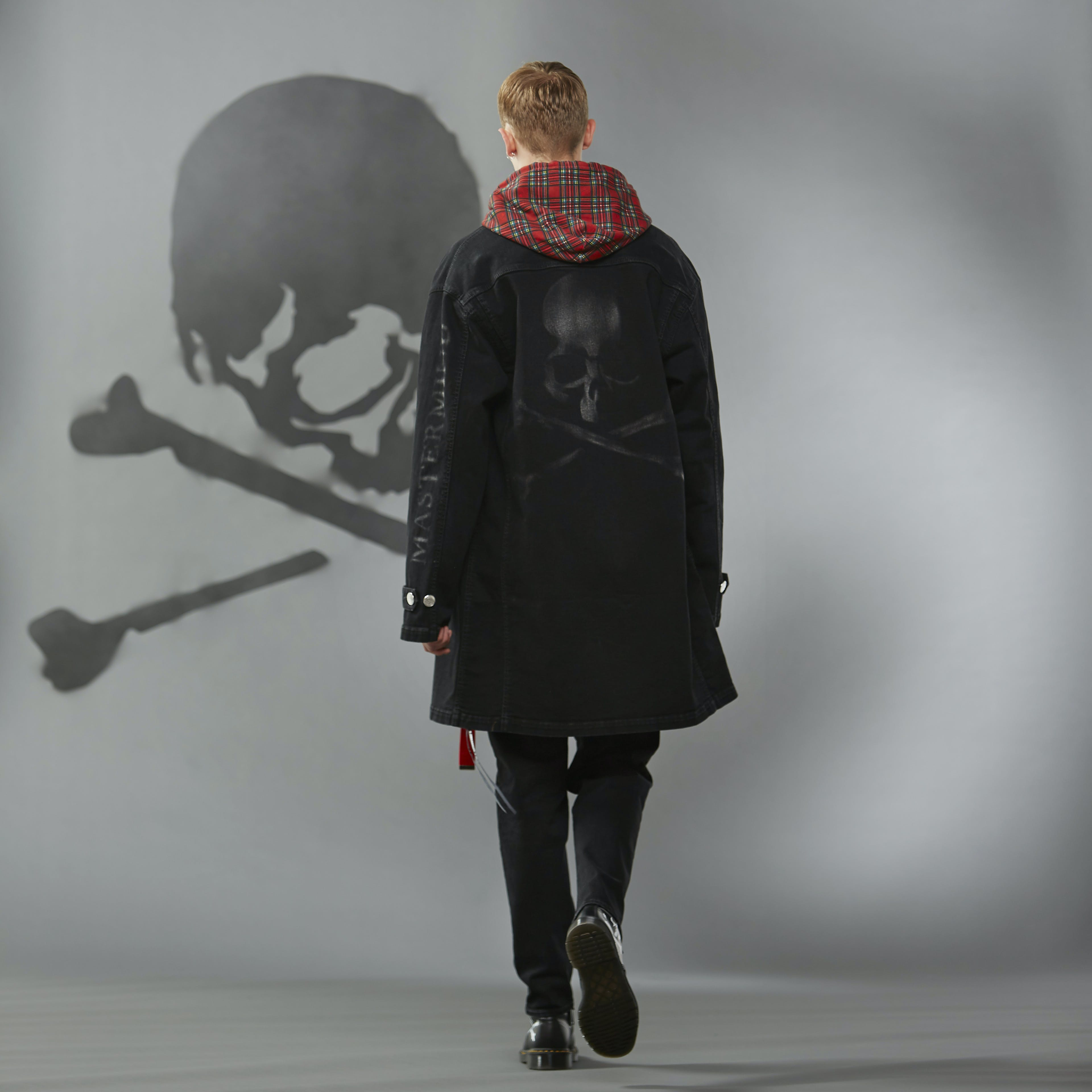 MASTERMIND WORLD FW19 look book presentation with tartan hooded sweatshirt and tonal skull motif to reverse