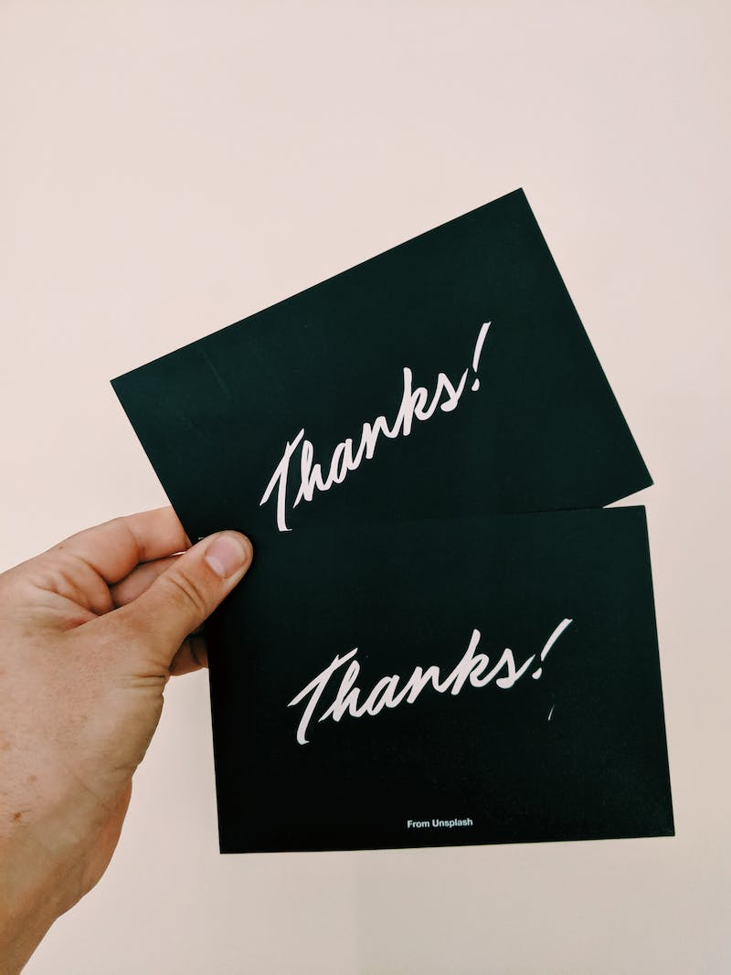 hand holding thank you cards