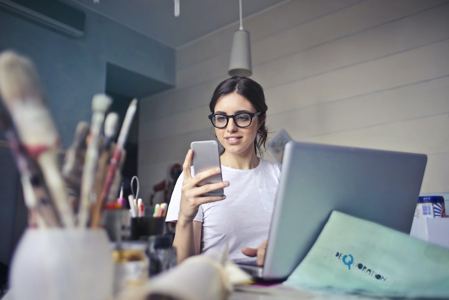 girl on phone at computer