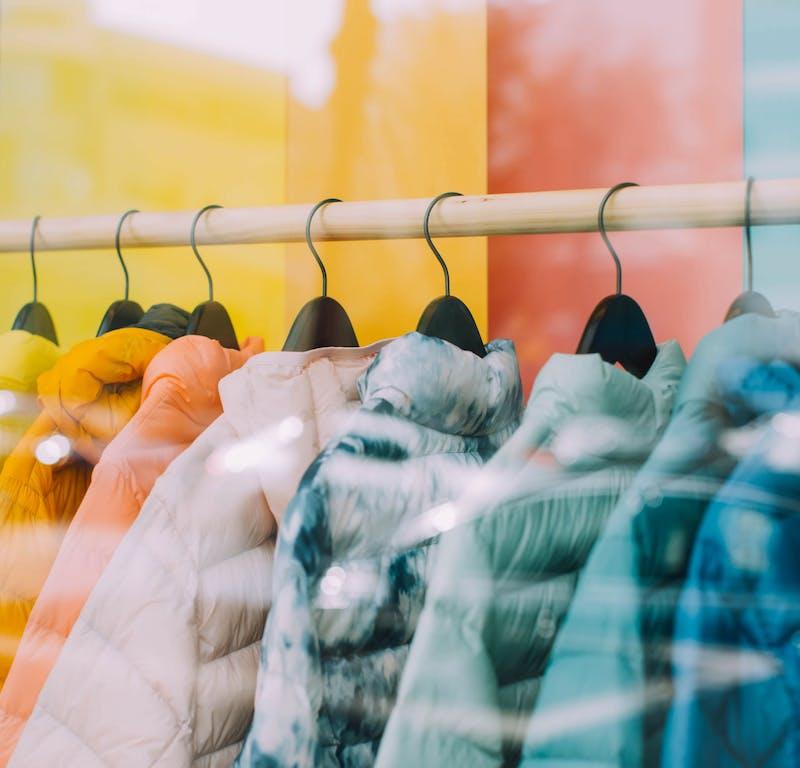 coats hanging on a rack