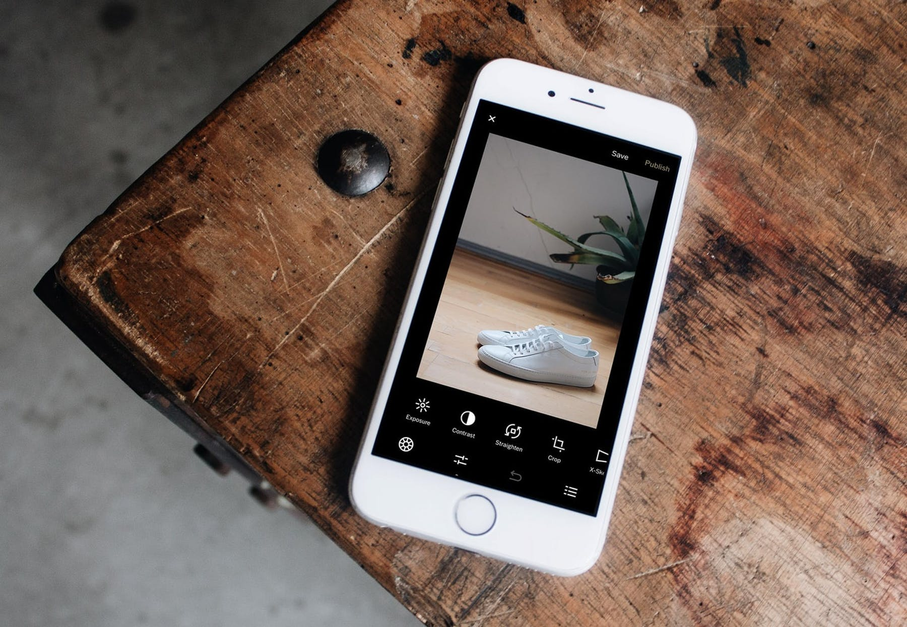 mobile phone with white sneakers