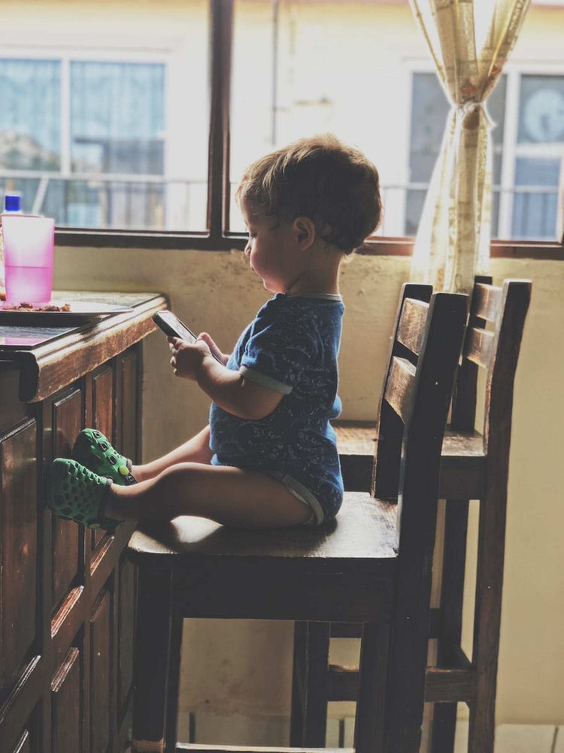 toddler using mobile phone
