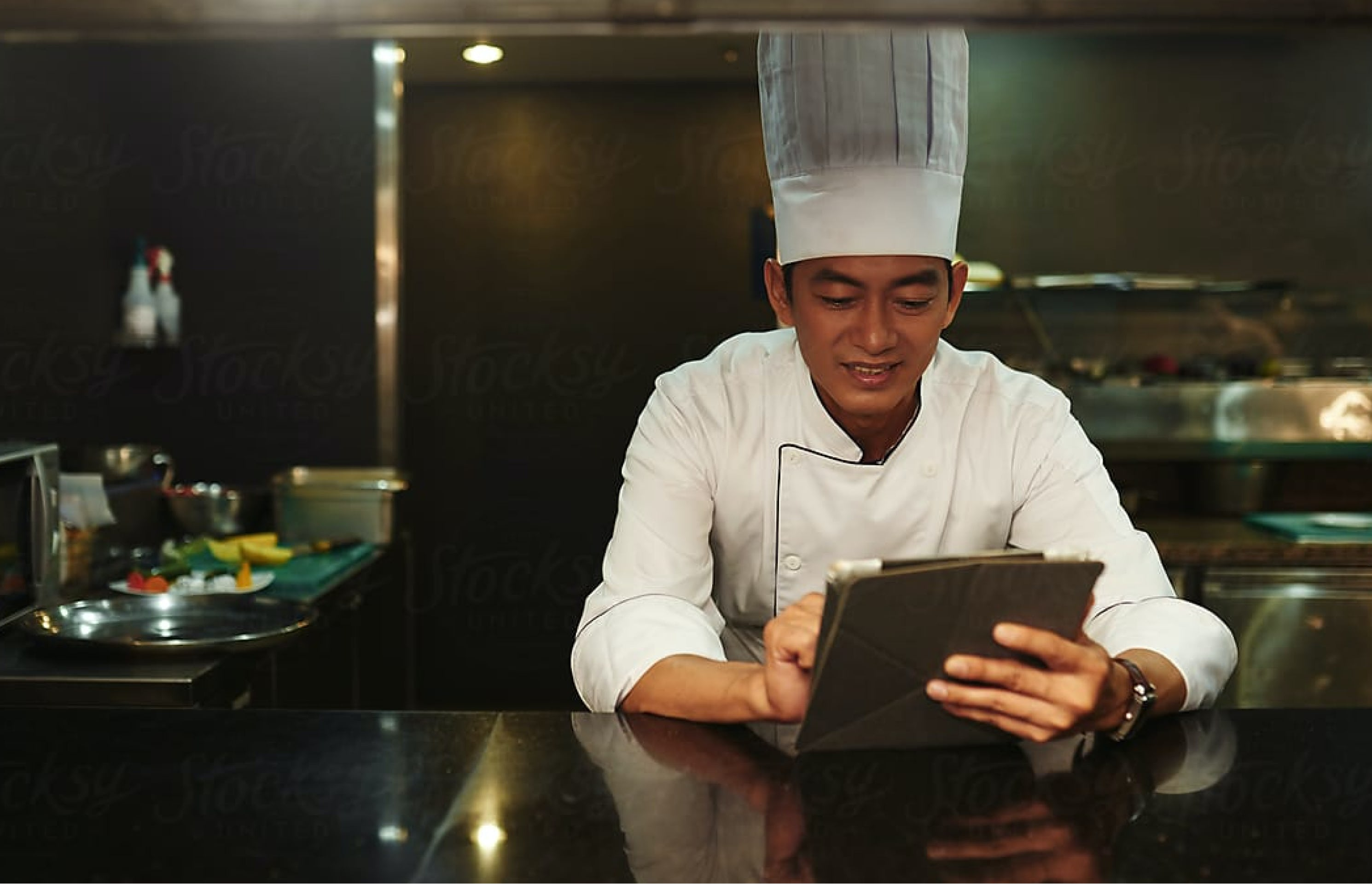 chef-using-an-ipad-in-a-cloud-kitchen-smartcitykitchens-singapore