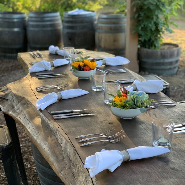 rustic wooden table setting with flower arrangements