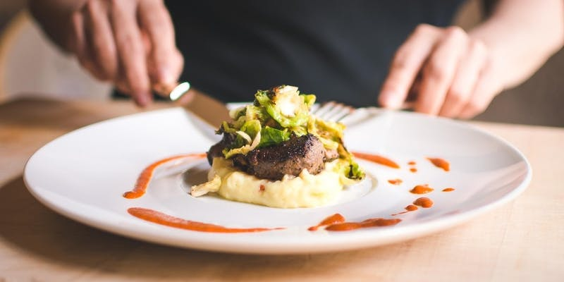 private chef steak dinner with mashed potatoes and brussel sprouts