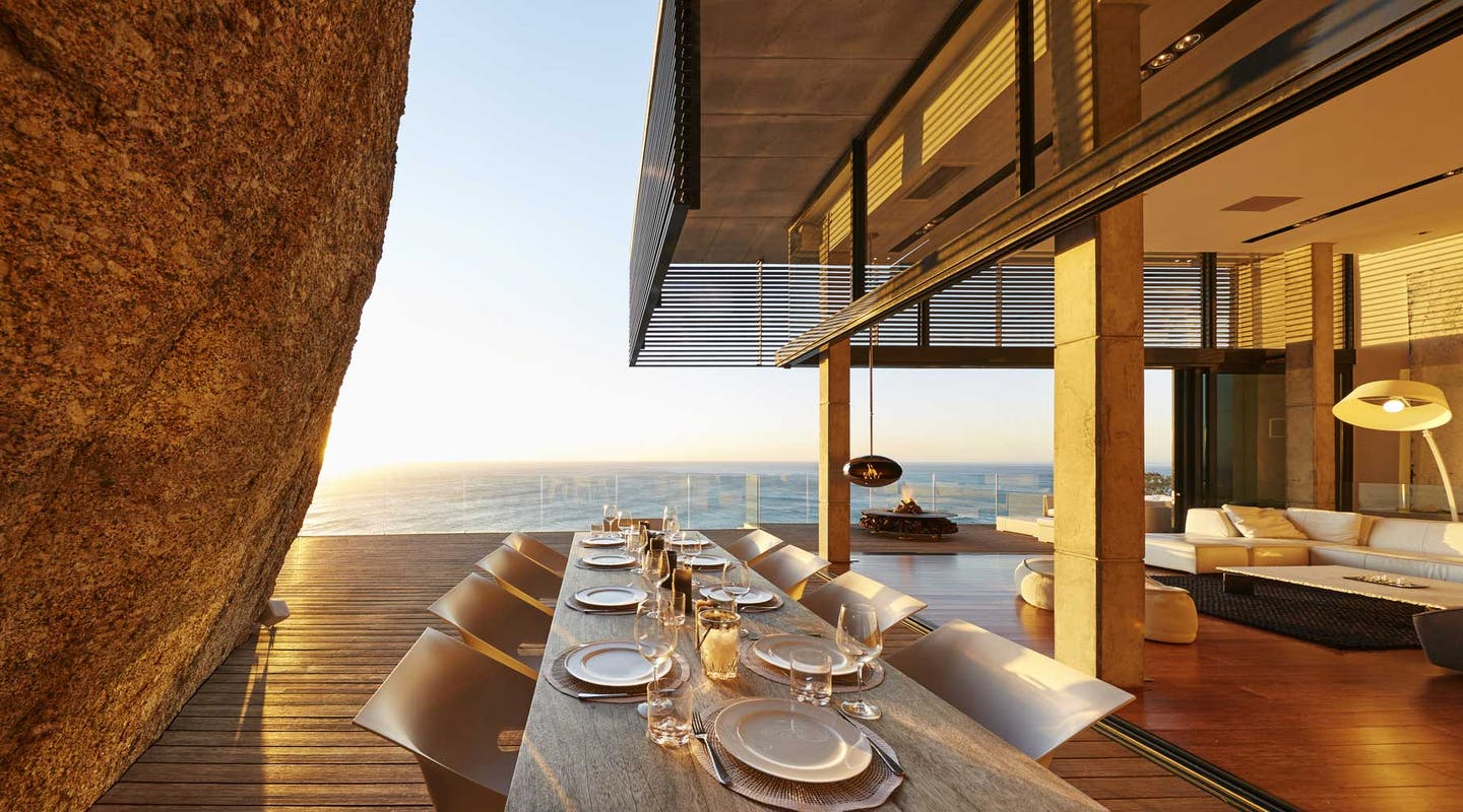 fine dining table setting in luxury home with ocean view