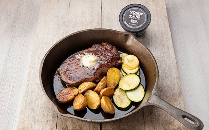 Steak in Cast Iron pan with Black Truffle Butter