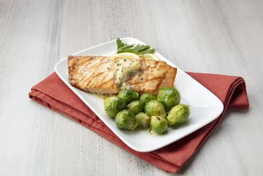 Salmon With Epicurean Roasted Garlic Herb Butter