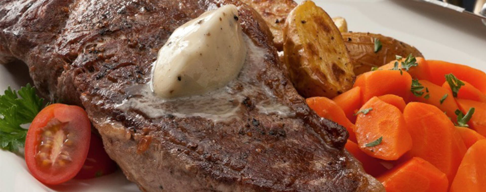 Grilled Steak with Black Truffle Butter melted on top