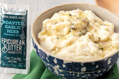 Bowl of mashed potatoes and 1oz squeeze packet of Roasted Garlic Herb flavored butter