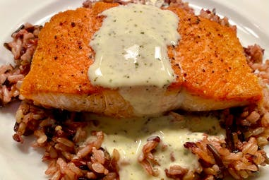 Salmon with creamy tuscan herb butter sauce
