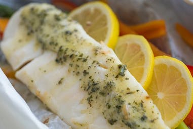 Fish baked in parchment with Lemon Garlic Herb flavored butter