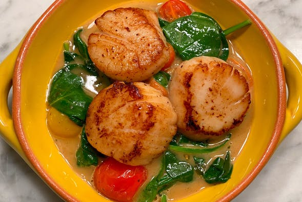 Scallops with Epicurean Roasted Garlic Herb butter.