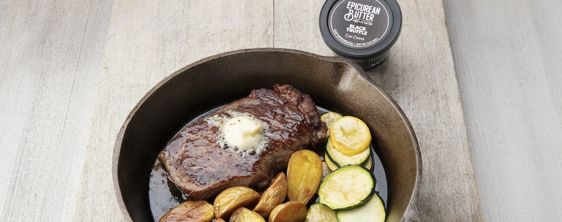 Grilled steak topped with Epicurean Black Truffle flavored butter