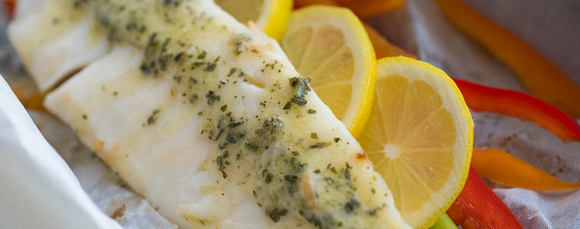 Fish Baked in Parchment with Lemon Garlic Herb Butter