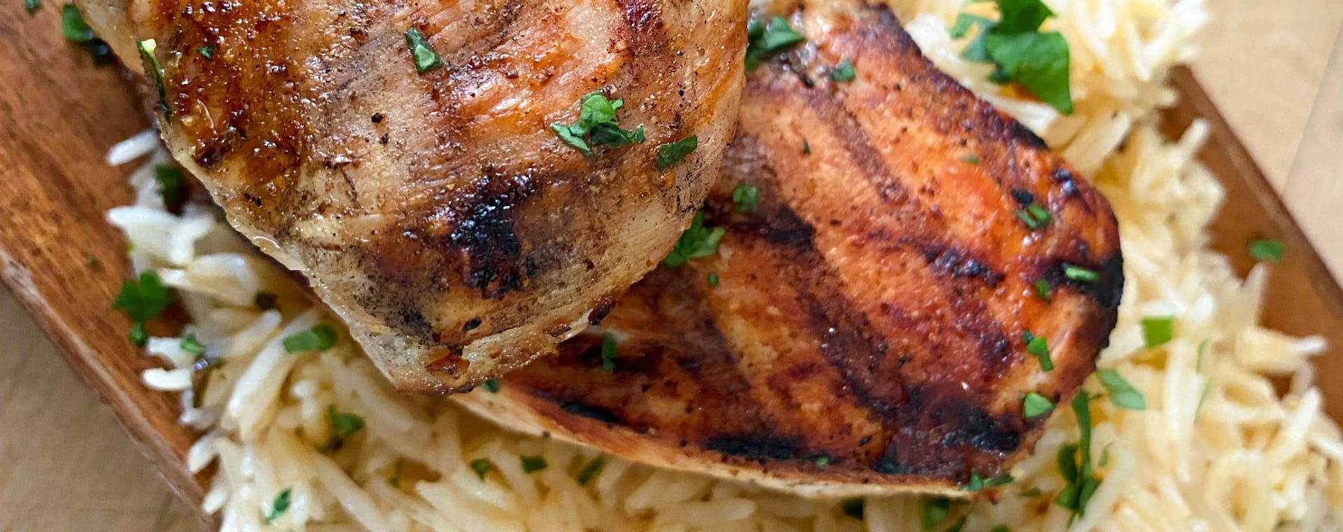 Grilled chicken and rice made with Epicurean Chili Lime flavored butter