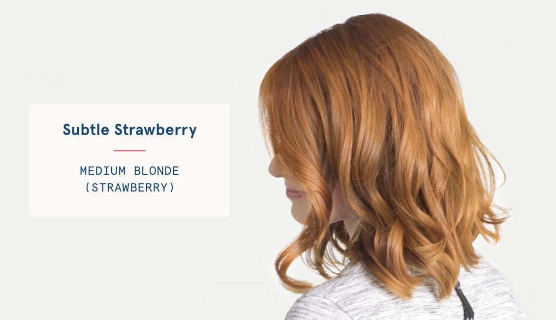 Image of woman with subtle strawberry custom red hair color, she has a medium blonde base with strawberry tones