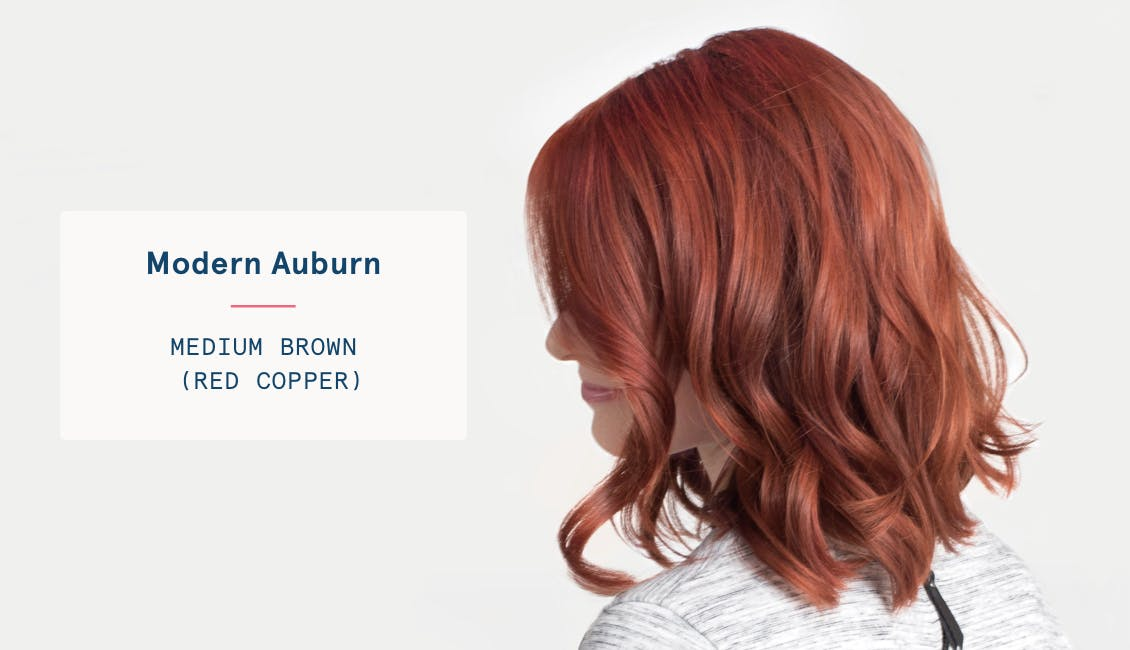 Image of woman with modern auburn custom red hair color, she has a medium brown base and red copper tones