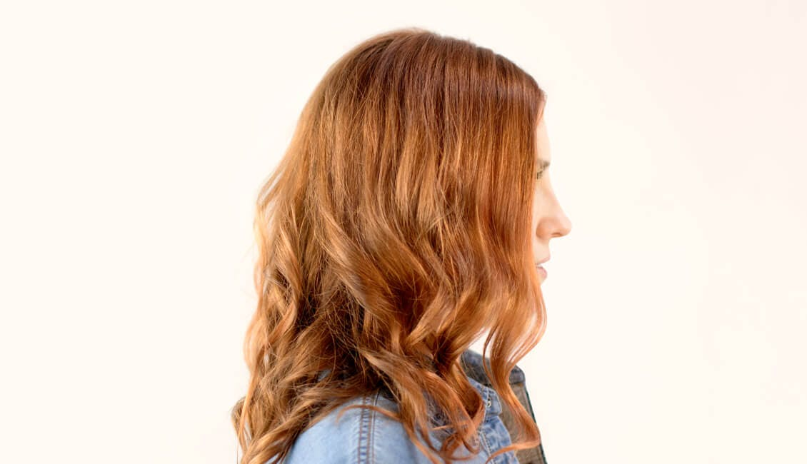 Image of esalon client Julia in a custom pumpkin spice hair color trending for fall