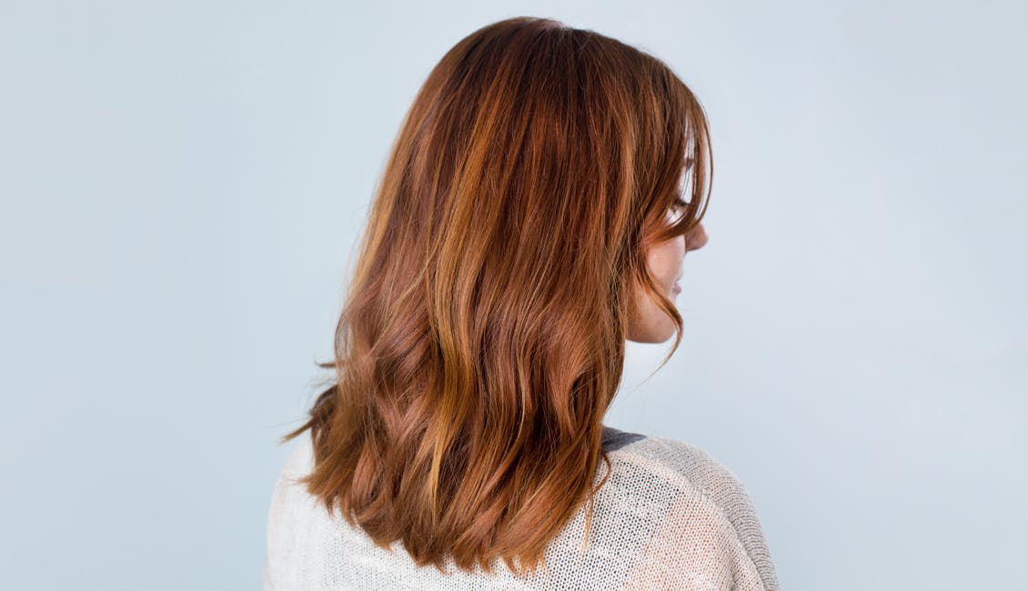 Image of esalon client with custom strawberry copper hair color trending in summer