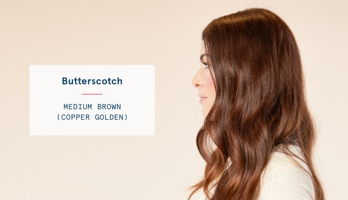 Image of woman's profile with long hair in custom butterscotch brunette hair color