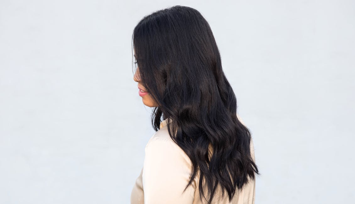 Image of esalon client with custom black coffee negroni hair color