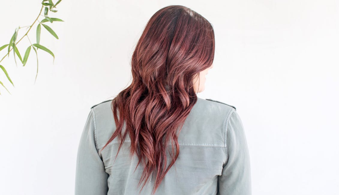 Image of eSalon client with trending custom warm chocolate cherry hair color for spring