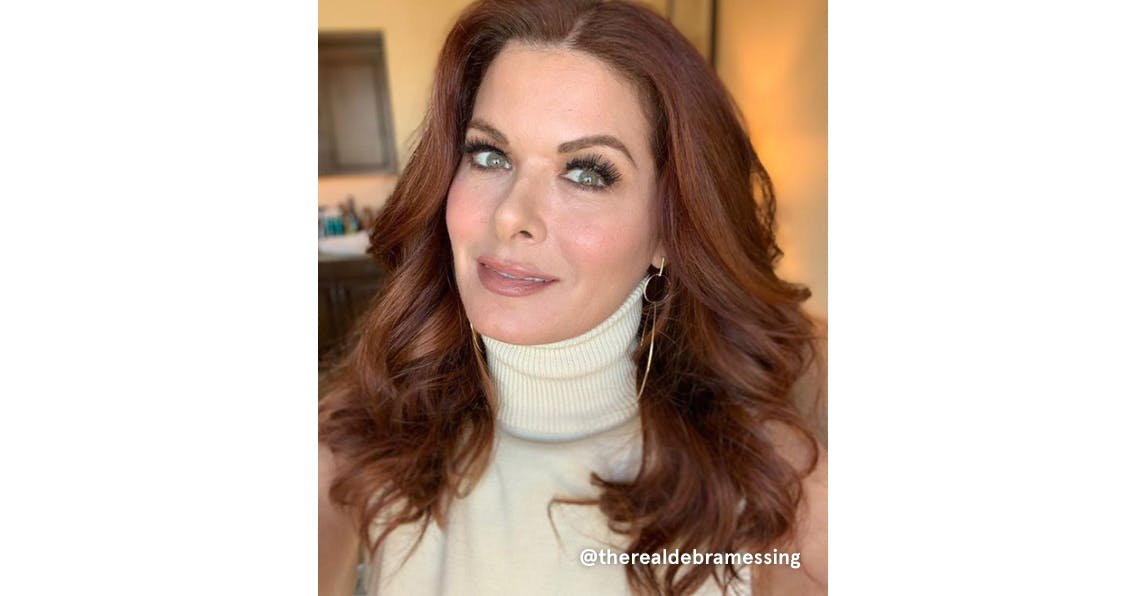 Debra Messing with red hair and a warm skin tone to match.