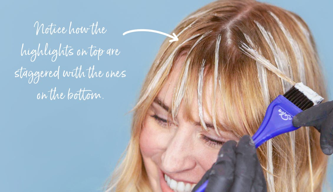 Image of esalon colorist staggering her esalon light set balayage highlights with bangs for a more natural look